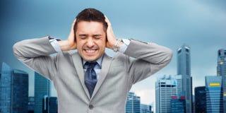 Businessman in suit having head ache Stock Images