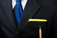 Businessman suit and his notebook Stock Photos