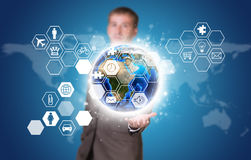 Businessman in suit hold Earth and hexagons with Stock Photography