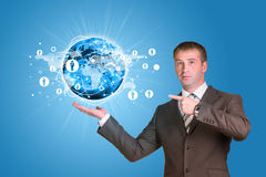 Businessman in a suit hold Earth with lines Royalty Free Stock Photography
