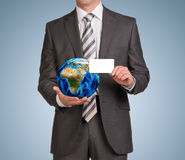 Businessman in suit hold empty card and Earth Royalty Free Stock Image