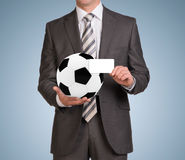 Businessman in suit hold empty card and soccer Stock Image