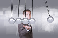 Businessman in suit hold Newtons cradle Royalty Free Stock Photos