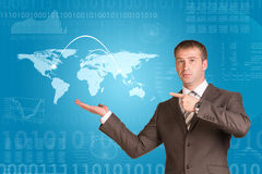 Businessman in a suit hold world map Stock Photo