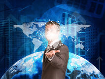 Businessman in a suit hold world map Royalty Free Stock Photos