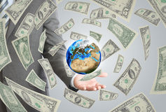 Businessman in a suit holding a earth Stock Photo