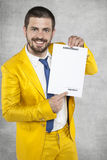 Businessman in a suit holding a gold contract for work stock photo