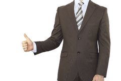 Businessman in a suit holding his thumb up Stock Image