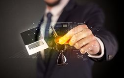 Businessman holding keys with graphs around Royalty Free Stock Photos