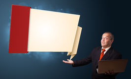 Businessman in suit holding a laptop Stock Photography