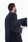 Businessman in suit holding laptop Stock Photo