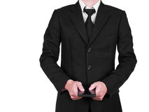 Businessman in a suit holding a mobile phone Royalty Free Stock Photo