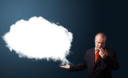 Businessman in suit holding a phone and presenting abstract cloud copy space Royalty Free Stock Photo