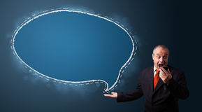 businessman in suit holding a phone and presenting speech bubble copy space Royalty Free Stock Images