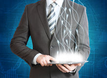 Businessman in a suit holding a tablet computer Stock Photo