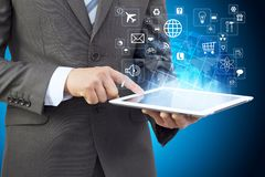 Businessman in a suit holding a tablet computer Stock Photography
