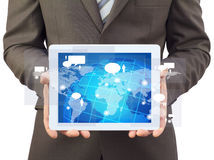 Businessman in a suit holding a tablet computer Royalty Free Stock Photo