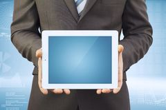 Businessman in a suit holding a tablet computer Stock Image
