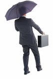 Businessman in suit holding umbrella and briefcase Royalty Free Stock Photos