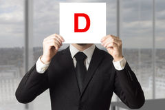 Businessman in suit holding up sign with letter d Royalty Free Stock Photography
