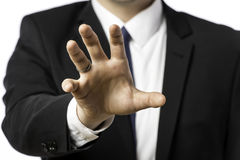 Businessman in a suit holds out his hand Stock Photos