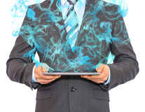 Businessman in a suit holds tablet pc with smoke Stock Images