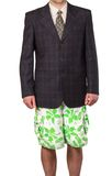 Businessman in suit jacket but in summer shorts isolated at the Royalty Free Stock Photography