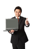 Businessman in suit with laptop Royalty Free Stock Photography