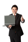 Businessman in suit with laptop Royalty Free Stock Photo