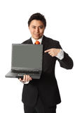 Businessman in suit with laptop. Attractive businesman showing on a laptop computer. Wearing a suit and orange tie. White background royalty free stock photo