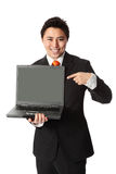 Businessman in suit with laptop. Attractive businesman showing on a laptop computer. Wearing a suit and orange tie. White background stock photo