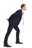 Businessman in suit leaning over Royalty Free Stock Image