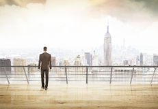Businessman in suit looking at city. Of New York thinking and planning right strategy for his project. Concept of decision making Royalty Free Stock Photography