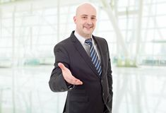 Handshake. Businessman in suit offering to shake the hand, at the office Stock Photography