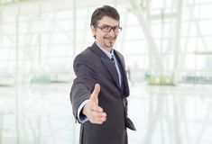 Handshake. Businessman in suit offering to shake the hand at the office Stock Photos