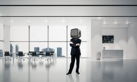 Businessman with an old TV instead of head. Royalty Free Stock Photography