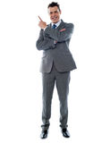 Businessman in suit pointing at copyspace Royalty Free Stock Image