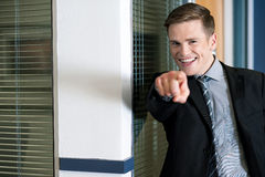 Businessman in suit pointing finger stock image