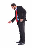 Businessman in suit pointing finger. On white background Stock Image