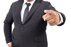 Suit pointing with his finger. Businessman in a suit pointing with his finger Royalty Free Stock Photos