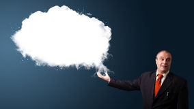 Businessman presenting abstract cloud copy space Stock Images