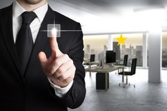 Businessman in suit pushing button one star rating. Businessman in black suit pushing button one star rating royalty free stock photos