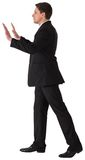 Businessman in suit pushing with hands Royalty Free Stock Photo