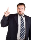 Businessman in a suit with a raised index finger Stock Photography