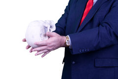 Businessman in suit red tie holding a human skull Royalty Free Stock Images