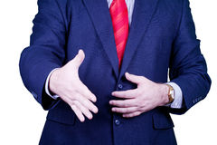 Businessman in suit and red tie ready handshake Stock Images