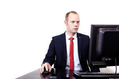 Businessman in  suit with a red tie sits on Royalty Free Stock Photography