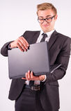 The businessman in the suit rejoice in the successes of and hold Royalty Free Stock Image