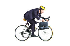 Businessman in a suit riding a bike. Businessman in a suit with a briefcase riding a bicycle stock images