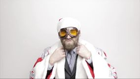 Businessman in a suit of Santa Claus smiling and adjusts his tie stock video